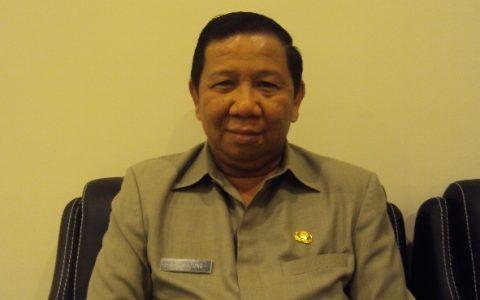 Adrianus Nixon Watung SH