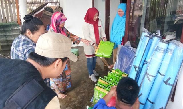 Dinsos Kotamobagu Serahkab Bantuan Bagi Korban Banjir