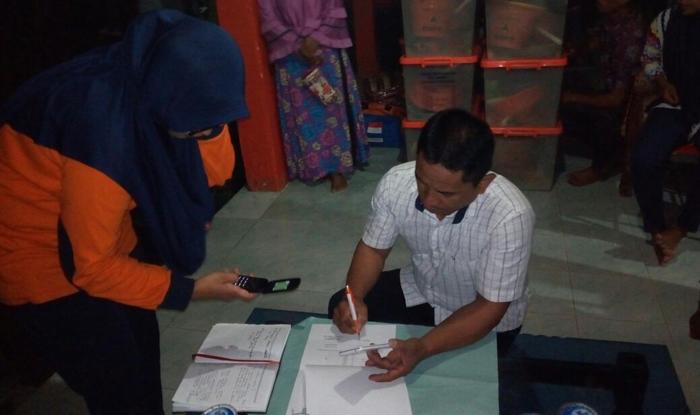 BPBD Bolmong Serahkan Bantuan Untuk Korban Banjir di Desa Solimandungan